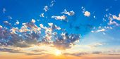 Real majestic sunrise sundown sky with sun, sun rays and colorful clouds, huge size poster