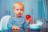 Boy Cute Baby Eating Breakfast. Baby Nutrition. Eat Healthy. Toddler Having Snack. Healthy Nutrition poster