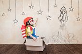 Kid Playing With Toy Rocket At Home poster