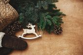 Zero Waste Christmas. Rustic Reindeer Toy, Gloves, Basket With Fir Branches And Cones On Rustic Wood poster