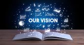 OUR VISION inscription coming out from an open book, business concept poster