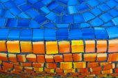 Street Mosaic Pattern Of Orange And Blue Stone. Beautiful Mosaic Pattern Close Up. Orange And Blue T poster