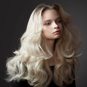 Beautiful young woman. Gorgeous blonde hair. poster