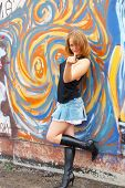 stock photo of slut  - Bad blonde girl near graffiti wall she so sexy - JPG