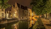 Romantic Nocturnal View Of A Canal In Bruges. Night View Of Famous Bruges City View, Belgium, Nights poster