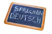 sentence sprechen deutsch, german is spoken, written on a chalkboard