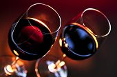image of red wine  - Two wineglasses with red wine at candlelight - JPG