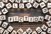 Fiction - Word From Wooden Blocks With Letters, Literary Genres Concept, Random Letters Around, Top  poster