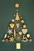 Abstract Christmas tree decoration with gold baubles, ornaments and symbols on mottled green backgro poster