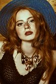 Beauty, fashion. Portrait of a beautiful red-haired girl dressed in modern hippie style. Bohemian st poster