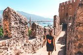 Traveler Exploring The City Of Alanya In Turkey. Woman Walking And Discovering Old Landmark In Europ poster