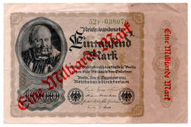 stock photo of billion  - Front side of a German bank note from 1922 which has been upgraded with a stamp during hyper inflation - JPG