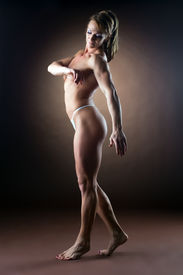 foto of athletic woman  - strong woman body builder walk side show naked spine - JPG