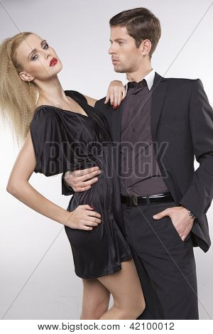 Portrait of elegant couple on grey background