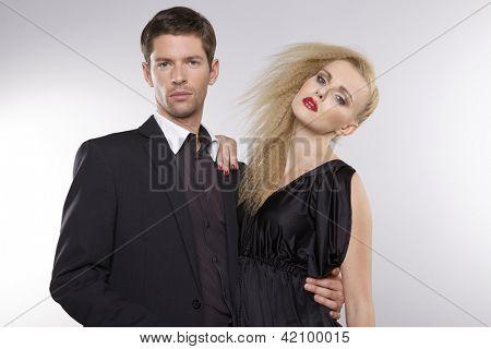 Portrait of elegant couple on grey background
