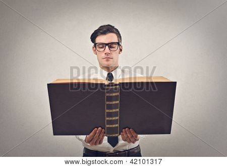 businessman reading a huge book