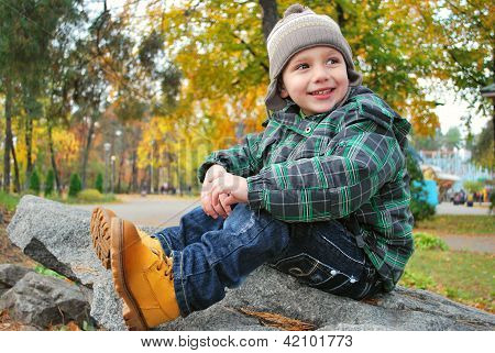 Beautiful boy in the autumn park