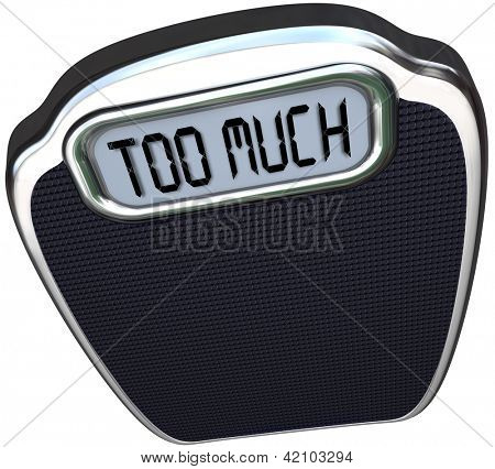 The words Too Much on the digital display of a scale symbolizing surplus, overabundance, overweight, fat and in need of a diet