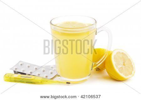 Hot lemon drink as home remedy concept with clinical thermometer and pills on white
