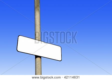 Blank White Sign Against A Blue Background