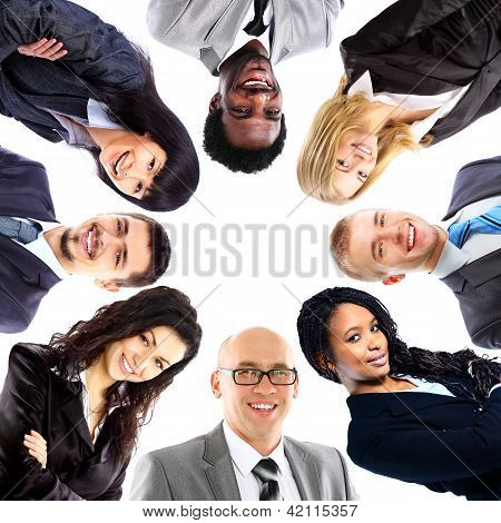 Group of business people standing in huddle smiling low angle view