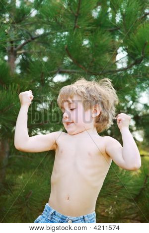 Little Boy Showing His Muscles
