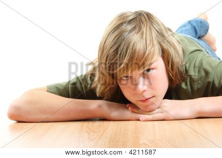 Teen Boy Laying His Head On His Hands