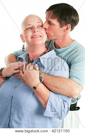 Cancer patient supported by her loving husband.  White background