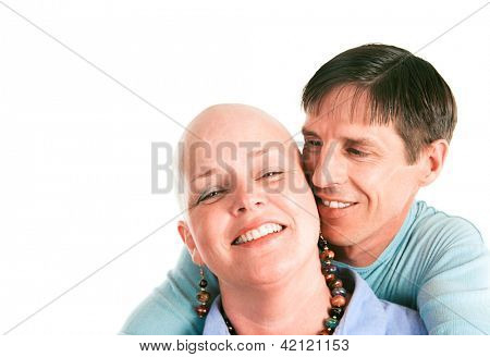 Female cancer survivor posing with ther loving husband.
