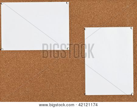 White Sheets Of Paper On Cork Board