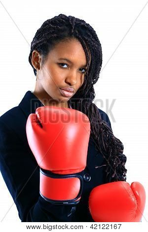 Young African American woman wearing boxing gloves