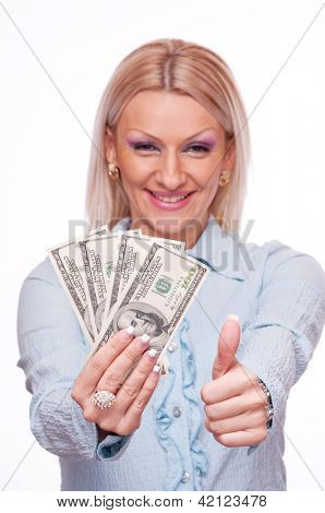 Beautiful business woman showing Dollar bills in one hand and thumb up with other hand