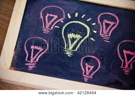 Funny Lightbulb On Blackboard, Concept Of Uniqueness