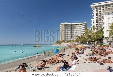 Tourists On Busy Beach Of Waikiki