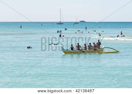 Tourists Off Coast Of Waikiki In Traditional Canoe