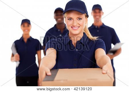friendly young delivery woman presenting parcel with colleagues