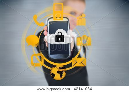Businesswoman holding up locked smart phone with orange applications on grey background