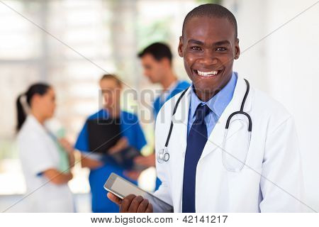 handsome african american healthcare worker with tablet computer