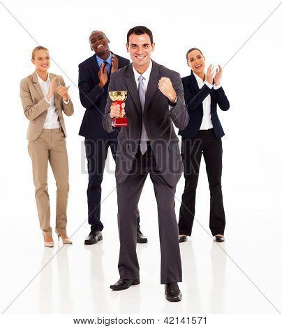 smart businessman and team winning a trophy