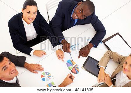 overhead view of group of business people having meeting together