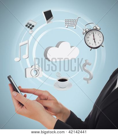 Businesswoman using applications on mobile phone and cloud computing on blue background