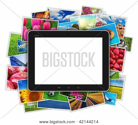 Blank tablet computer on heap of colorful photos