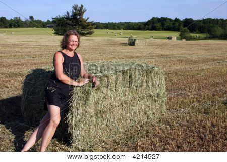 Woman On A Hay Bale