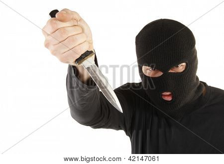 Masked man aims with knife