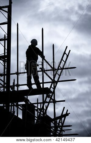 scaffolding silhouette of construction worker, Blue toned