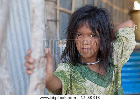 A Young Girl Lives In A Fishing Village And Tourist Poses For A Dollar