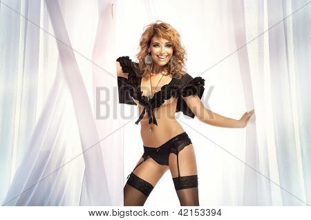Photo Of Beautiful Young Blond Smiling Woman In Black Lingerie Dancing