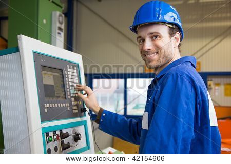 Construction Worker Operating A Machine