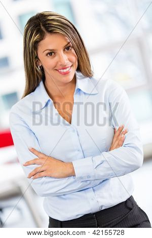 Bossy business woman with arms crossed at the office