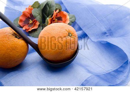 Fresh Ripe Tangerine on blue underlayment